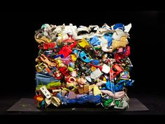 "Wesley Law's series ""Baled' is a photography project that follows some of the millions of pounds of everyday items discarded annually in the US and shipped overseas to be recycled. Beginning in a massive warehouse space in St. Louis, Law decided to take a closer look and discovered that each bale had, ""their own personality, their own identity."" He explains, ""I think when people look at what's embedded in these things, it evokes our past and our memories."""