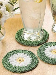 These daisy coasters will bring Spring to your home at any time of year! The yellow-centered white daisies feature the Roll Stitch. Crocheted with worsted weight cotton yarn and size H hook, a set of coasters can be completed in one evening.Skill Level: Intermediate