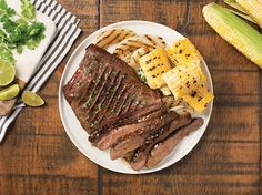 Cuban-Style Flank Steak This Cuban-inspired steak platter makes for the perfect summer barbecue feast. Flank steak is a lean and flavorful cut of steak that is budget-friendly when serving a crowd. Corn Recipes, Beef Recipes, Tostadas, Steaks, Bbq Flank Steak, Goya Recipes Puerto Rico, Goya Sazon Recipe, Mojo Chicken, Pineapple Salsa