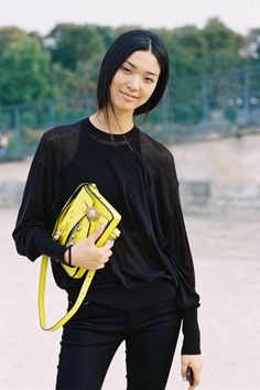 Tian Li in all black with a POP of fluoro yellow Versace clutch #Paris #StreetStyle
