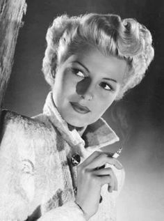 Rita Hayworth as Elsa Bannister, she was the good lookin and deadly Femme Fatale blonde from ''Lady From Shanghai'' 1947