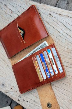 Full option brance brown leather iphone wallet (able to request name stamp) on Etsy, £24.54
