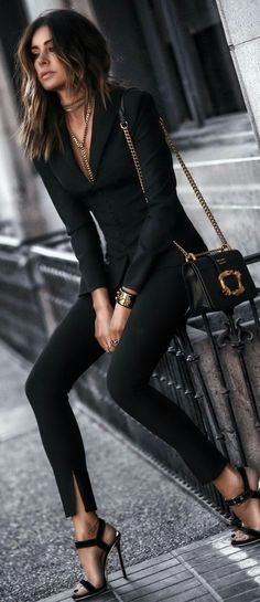 Edgy black suit. Love style, cut, and jewelry