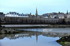 Seascape at Saint Malo coastline. Old city rampart with breakwater in reflection. Ille et Vilaine, Brittany, France. #st #malo