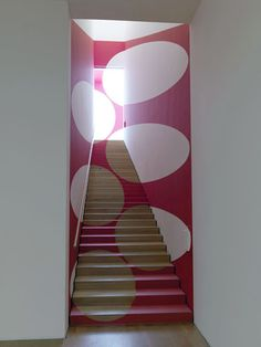 Painted staircase by Felice Varini, a Swiss artist known for his geometric perspective-localized paintings using projector-stencil techniques.