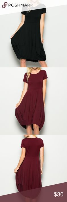 Jenna Round Neck Tulip Dress d e s c r i p t i o n  This cute round neck, high-lo hem, tulip cut dress is a must have closet basic that is so versatile! It transitions beautifully from the office to the family BBQ, and with breathable material is perfect for hot summer days.   c o n t e n t  95% rayon | 5% spandex    m e a s u r e m e n t s ✂️  relaxed fit   p a i r e  w i t h   + Steve Madden Caryssa Pumps    bundle for a discount Vega Boutique Dresses Midi
