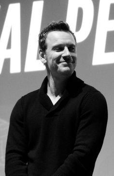 Michael smiling at Chiwetel after the second screening at TIFF. And the neck porn. :-P