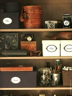 Mix a vintage collection with handsome organizer boxes for an uncluttered, masculine look.