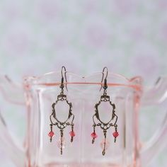 Elegant Victorian-style earrings feature light silk (blush) crystal teardrops and padparadscha (peach) bicones