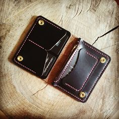 First attempt at a short biker/trucker type wallet /purse. 3 card pockets, two full size pockets, and a zippered coin pocket. Black chromexcel with solid brass hardware and D-ring.