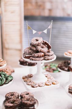 Doughnuts at the dessert table. Photo by Feather & Twine Photography. #desserttable #weddingreception #food&drink