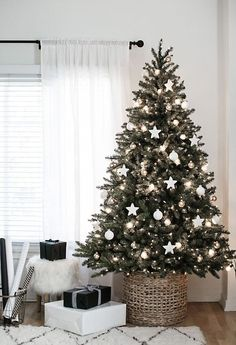 Love this Christmas tree in a basket stand instead of a tree skirt