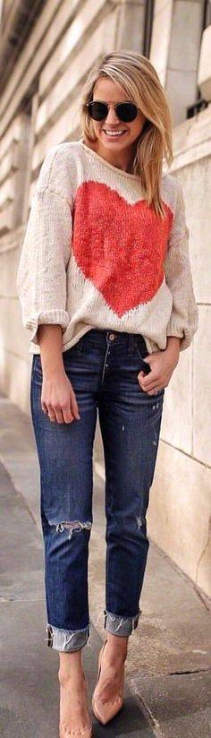#spring #outfits woman in grey-and-red heart-printed sweater and distressed jeans taking a pose. Pic by @styledsnapshots