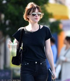 Fueling up: Dakota was seen sipping on a healthy green smoothie as she exited the stores