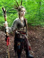 "This is an interesting one to remind and challenge me to think of where my ideas come from. I'm curious about the feathers and ""war paint"" in this costume. Costuming is so rife with appropriation, it's really easy to rely on deeply-rooted colonial concepts of ""tribal"" or ""native"" to mean ""wild"" and ""other"". // Wild Elf Shaman - 3/4 by EpicTeaWater"