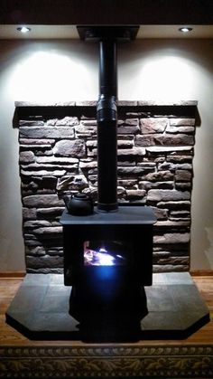 Woodburning stove, love the slate and hardwood - Wood Stove Surround, Wood Stove Hearth, Stove Fireplace, Fireplace Mantels, Fireplaces, Cabin Fireplace, Mantle, Buck Stove, Pellet Stove