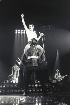 Freddie Mercury sitting on Darth Vader's shoulders.  1980.
