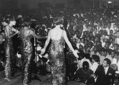 Diana Ross and the Supremes perform, with an attentive Berry Gordy down front.