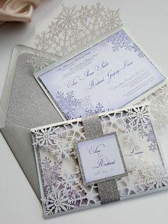 Winter invitations - snowflakes laser cut wedding invitation bespoke / http://www.himisspuff.com/unique-wedding-invitations/4/
