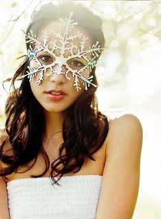 Snowflake leather mask in white. $39.00, via Etsy.