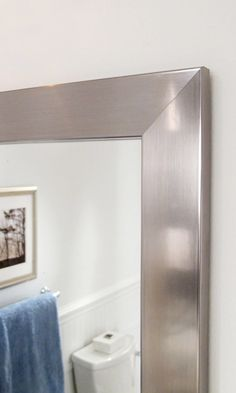 Finish a wall mounted mirror with a frame from MirrorMate.