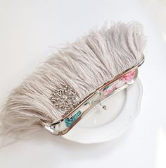 Ostrich Feather Clutch with crystal brooch  by SaraCaccessories, $144.00