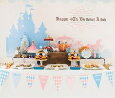 Darling Cinderella Birthday Party with silhouette stationery, vintage wishing tree, button cookies party favors in ragged brown bags and a Barbie doll cake!