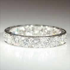it's ONLY $16,000 Gorgeous. Vintage French Retro 3.8ctw Diamond Eternity Ring in Platinum c.1940
