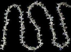 18 Feet Silver Iridescent Acrylic Diamond Twist Bead Garland for Christmas, Wedding or Party Decorating,$11.97