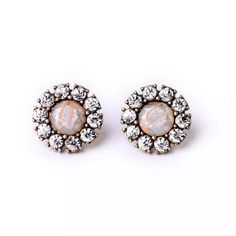 Vintage Natural Stone Silver Dust Stud Earrings Beautiful Stud Fashion Earrings! Vintage Gold With Clear Crystals surrounding a Natural Stone Silver Dust Fashion! Make a statement with these studs!!  • Lead & Nickel Free • For Pierced Ears  - Price Firm unless Bundled - Bundle 2 or more items for 20% Discount! - No Trades - PayPal is now accepted thru Posh! Boutique Jewelry Earrings