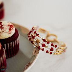Show off your sophisticated style with this handmade Bangle Bracelets that is inspired by the classic and delectable red velvet cupcake. The bracelet is made with radiant 22K Gold Plated beads, beautiful glass crystal beads in deep red and clear and a large gold-plated lobster clasp that effortlessly secures the bracelet to your wrist.