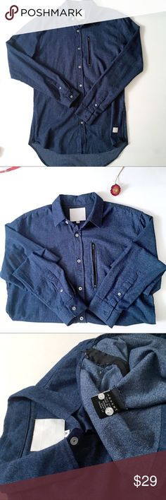 Absent Clothing Dark Denim Zip Detail Button Down Absent Clothing Dark Denim Washed Button Down with zipper details and high low hem. Size medium,100% cotton and in Perfect condition, brand new without the tags attached. Absent Clothing Shirts Casual Button Down Shirts