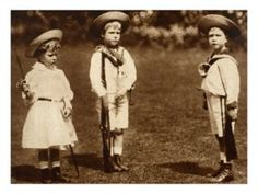 Royal pictures - A young King Edward VIII drilling his siblings the Duke of York and the Princess Royal 1899.jpg