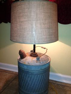 My hubby made this lamp for our cabin. Old gas can and burlap shade.