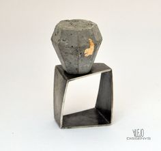 Silver ring rusty, cement and gold leaf. by Isabel Alejo