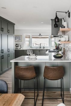 Check out this Grey Green Kitchen Tour with open shelving and bay windows! Love the leather stools in this modern kitchen! Home Decor Kitchen, Kitchen Remodel, Kitchen Decor, Farmhouse Style Kitchen, Green Kitchen, Home Kitchens, Modern Kitchen Design, Kitchen Renovation, Kitchen Design
