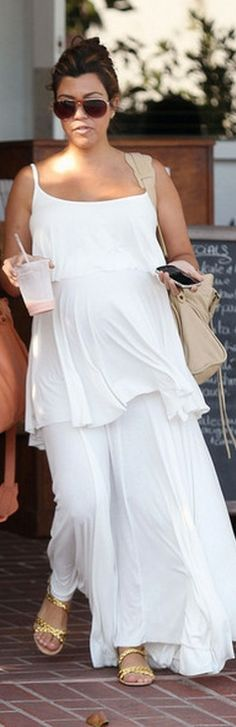 Who made Kourtney Kardashian's white tiered ruffle maxi dress, sunglasses, gold flat sandals and tan handbag that she wore in Hollywood on May 16, 2012? Dress – Rachel Pally  Purse – Balenciaga  Sunglasses – Kardashian Kollection  Shoes – Stella McCartney