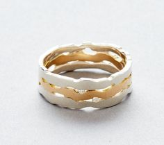 Sterling silver and 14k yellow gold triple ridge ring with 2, 2mm diamonds. www.curiosityandhappenstance.com