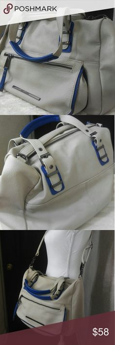 Steve Madden Tote with Crossbody Strap *NWOT* Steve Madden Tote with Crossbody Strap. Large tote with two handles and cross body strap. One big center section and outside has smaller seperate zipper section. Super cute and trendy black and white lining on inside. This is a creamy gray tan color with bright cobalt blue detail (the picture doesn't do it justice) Also it is very soft and buttery. My fav part is the black hardware.   **If this doesn't sell by mid June, I will be keeping for…
