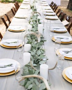 I loved how our Henderson Farm Tables looked lined up as a head table for this Lake Tahoe wedding  the gorgeous eucalyptus runner from Foothill Flowers looked perfect with the Antlers & Pillar Candles  and the Gold Chargers were perfect with the simple place settings  simple rustic mountain wedding  perfection!  @melaniesoliel  #tinrooffarmhouse #weddingrentals #lakewedding #mountainwedding #laketahoewedding #outdoorwedding #farmtable #farmhousedecor #headtabledecor #weddingdesign…