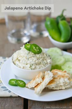 Jalapeno Artichoke Dip 1 cup marinated & drained artichoke hearts 1/2 cup grated parmigiano reggiano cheese 4 oz. cream cheese 1/4 cup mayonnaise salt & pepper, to taste splash of water 1-2 tablespoons finely chopped jalapenos