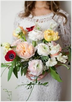 wedding bouquet, poppies, peonies, hits of red with yellow, pink, whites and creams.
