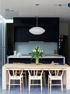 Contemporary Kitchen - black kitchen cabinets, white countertops and a natural wood dining table with matching chairs. One statement modern pendant hangs from the ceiling above the table. Black Kitchens, Cool Kitchens, Kitchen Black, Kitchen Interior, Kitchen Design, Kitchen Dinning, Dining Room, Kitchen Wood, Dining Tables