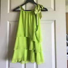 LIME halter style blouse Lime is the true color! It has three tiers of ruffle. Perfect for spring and summer! True to size, could fit someone size 14-18. Smoke/pet free. No dryer use. Cato Tops Blouses