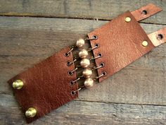 Steam Punk Handmade Metallic Bronze Leather and Pearls Steampunk Corset Cuff Bracelet Beige Neutral Leather Jewelry. $48.00, via Etsy.
