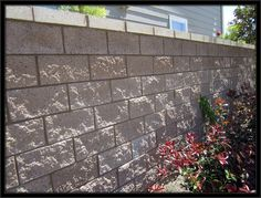 Our concrete block walls and retaining walls offer superior strength and beauty. Orange County's most reliable block wall contractor. Concrete Block Walls, Wooden Fence, Orange County, Sidewalk, Yard, Outdoor Structures, Building, Rammed Earth, Rock
