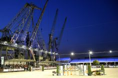 The incredible backdrop to the #showjumping arena - #Antwerp port cranes!