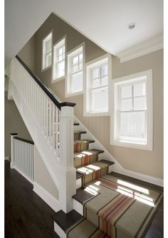 Energize your stairway with a carpet runner decked in stripes to go the distance