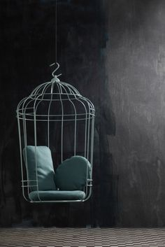 I love bird cages...maybe in a white room though so it doesn't look like a prison cell...