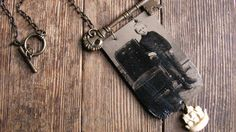 Love the tintype hanging from a key...Tintype Assemblage Necklace . Nate the Sailor Boy. $125.00, via Etsy.